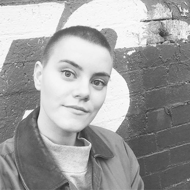 Female singer with shaved head